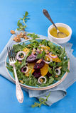 Healthy beet salad with orange, arugula, red onion and walnuts Royalty Free Stock Photos