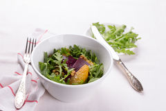 Healthy beet salad with orange, arugula and walnuts Royalty Free Stock Photography