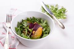 Healthy beet salad with orange, arugula and walnuts Stock Image