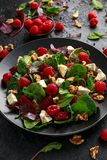 Healthy Beet Salad with raspberry, walnuts nuts and feta cheese royalty free stock photo