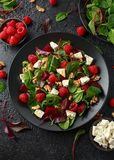 Healthy Beet Salad with raspberry, walnuts nuts and feta cheese stock photo