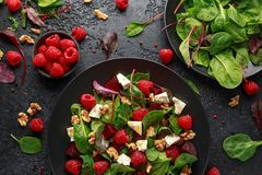 Healthy Beet Salad with raspberry, walnuts nuts and feta cheese stock photography