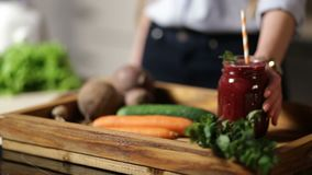 Healthy beet smoothie in mason jar on wooden tray stock footage