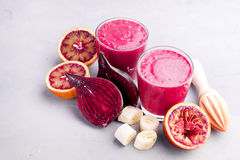 Healthy beetroot, orange and banana smoothie Wooden background Copy space Healthy food. Red oranges banana and beetroot smoothie Healthy food royalty free stock image