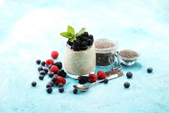 Healthy berry chia pudding in a jar with scattered fruit isolate stock image