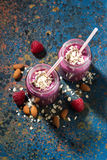 Healthy berry smoothie in a bottle and dark background, top view. Vertical Stock Photos