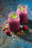 Healthy berry smoothie in a bottle on a dark background. Vertical Royalty Free Stock Photo