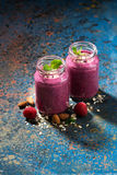 Healthy berry smoothie in a bottle and dark background, vertical. Top view Stock Photos