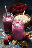Healthy berry smoothies with oatmeal, closeup, vertical. Top view Stock Photo