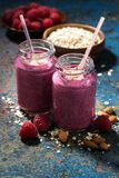 Healthy berry smoothies with oatmeal on a dark background. Vertical, closeup Stock Photography