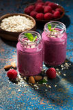 Healthy berry smoothies with oatmeal, vertical. Closeup Royalty Free Stock Photography