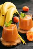 Healthy beverage - banana and apricot smoothie.  stock photos