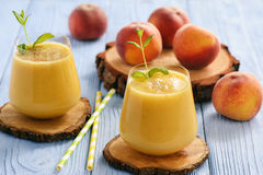 Healthy beverage - fresh blended peach smoothie. Healthy beverage - fresh blended peach smoothie Royalty Free Stock Image