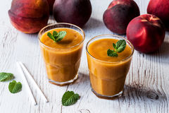 Healthy beverage - fresh blended peach smoothie with mint.  Royalty Free Stock Images