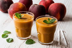 Healthy beverage - fresh blended peach smoothie with mint.  Stock Photos