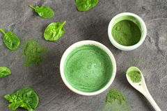 Healthy beverage made from green raw ingredients. On a dark gray background stock image