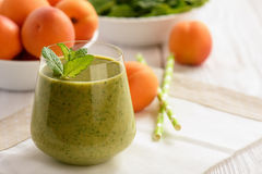 Healthy beverage - spinach and apricot smoothie. Healthy beverage - spinach and apricot smoothie stock images