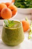 Healthy beverage - spinach and apricot smoothie. Healthy beverage - spinach and apricot smoothie stock image