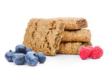 Healthy bio breakfast biscuits with blueberries. And raspberries on white background Stock Images