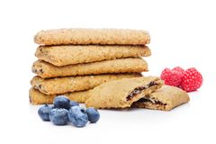 Healthy bio breakfast biscuits with blueberries. And raspberries on white background Royalty Free Stock Photos
