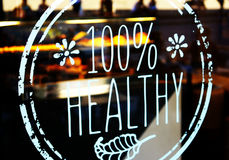 100% healthy bistrot glass decal. 100% healthy glass decal on a bistrot restaurant window Royalty Free Stock Photography
