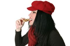 Healthy Bite. A woman takes a bite from a snack bar Royalty Free Stock Image