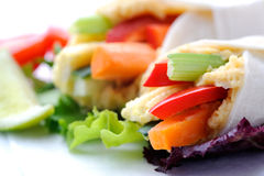 Healthy bite size wraps with carrot, capsicum and a side salad Royalty Free Stock Image