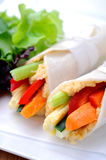 Healthy bite size wraps with carrot, capsicum and a side salad. Mini tortilla wraps with raw vegetable sticks Royalty Free Stock Photo