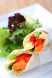 Healthy bite size wraps with carrot, capsicum and a side salad. Mini tortilla wraps with raw vegetable sticks Stock Image