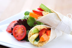 Healthy bite size wraps with carrot, capsicum and a side salad. Mini tortilla wraps with raw vegetable sticks Stock Photography