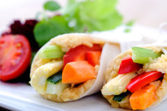 Healthy bite size wraps with carrot, capsicum and a side salad. Mini tortilla wraps with raw vegetable sticks, shallow depth of field Stock Photography