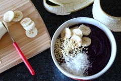 Healthy blackberry smoothie bowl with banana, almonds and coconut. royalty free stock photo