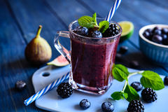Healthy blackberry smoothie with figs, blueberry and lime Stock Photography
