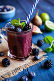 Healthy blackberry smoothie with figs, blueberry and lime Royalty Free Stock Photos