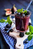 Healthy blackberry smoothie with figs, blueberry and lime Royalty Free Stock Images