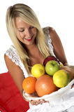 Healthy blond, with fruit Royalty Free Stock Photos