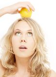 Healthy blond holding lemon on Stock Images