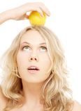 Healthy blond holding lemon on her head Stock Photo