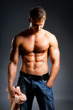 Healthy body. Beautiful guy with strong and sexy body holding the towel Royalty Free Stock Photography