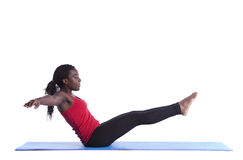 Healthy body balance. Young african woman exercising with perfect body balance (isolated on white Stock Photography
