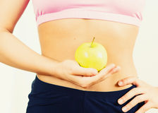 healthy body of woman with apple Royalty Free Stock Photos