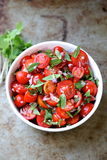 Healthy bowl of Cherry tomatoes and watercress Royalty Free Stock Photography