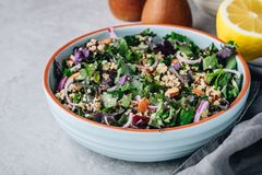 Healthy bowl kale and quinoa salad with cranberry, red onions and almonds stock photography