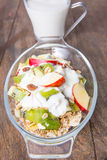 Healthy bowl of muesli, apple, fruit, nuts and milk for a nutrit Royalty Free Stock Photos