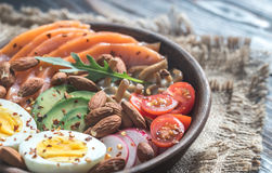 Healthy bowl with salmon, avocado, egg and vegs Royalty Free Stock Images
