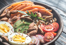 Healthy bowl with salmon, avocado, egg and vegs Stock Images