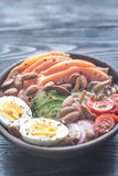 Healthy bowl with salmon, avocado, egg and vegs Royalty Free Stock Photo