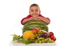 Healthy boy and fresh fruits Stock Photography