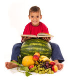 Healthy boy reading a book. Healthy boy learns about healthy life Royalty Free Stock Photography