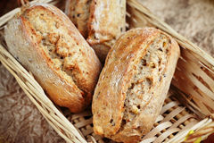 Healthy bread. Close up of whole grain rolls placed in wooden bread basket Royalty Free Stock Image
